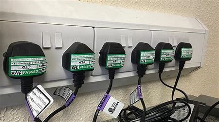 plugs in sockets with passed PAT test stickers